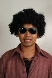 70s Guy. Dark complexion man ( Asian / Filipino / pass as Latino) in 70s afro, hairy chest and sunglasses Royalty Free Stock Images