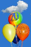 70th Birthday balloons. A bunch of 70th Birthday balloons against a blue sky Royalty Free Stock Photography