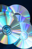 7149 Shiny glowing compact disks on black. Blue glowing, shiny compact disks on black background Royalty Free Stock Photo