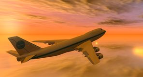747 plane at sunset. 747 flying in an yellow and orange sky at sunset Royalty Free Stock Images