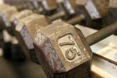 75 pound dumbbell. Row of dumbbells blurring into the background stock image