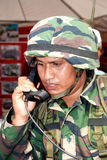 78th Malaysian Army Anniversary Celebrations 2011. KUALA LUMPUR, MALAYSIA-MAR 5:Unidentified soldier with a communication device at the 78th Army Anniversary Royalty Free Stock Photos
