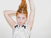 8个女孩头发她的老使用的年 图库摄影