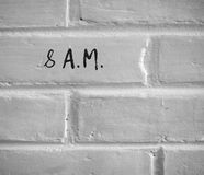 Free 8 A.M. WRITTEN ON WHITE PLAIN BRICK WALL Stock Image - 98785611