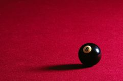 8 Ball on Pool Table. An 8 ball sits on red felt pool table Stock Photography