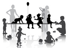8 children playing with some toys. With mothers Stock Photos