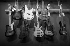 8 Electric Guitars Hanged on Brown Steel Bar Royalty Free Stock Images