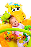 8 months old baby. Girl enjoy playing with soft baby toys. Studio shot. All toys visible on the photo are officially property released stock images