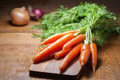 8 Piece of Carrot on Brown Chopping Board Royalty Free Stock Photos