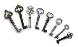 8 skeleton antique keys isolated Stock Photography