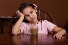 8 year old girl with coffee Royalty Free Stock Photo