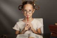 8 years old girl with books i Royalty Free Stock Photography