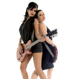 80's Glam Rock Girls. Sexy young glam rock guitarists playing guitars and standing back to back Stock Photo