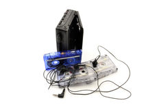 80's walkman, headphones and cassette tapes. On a white background Stock Photo