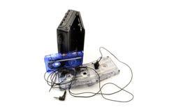 80-talwalkman, hörlurar och kassettband Arkivfoto