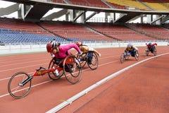 800 contadores de raza del sillón de ruedas de las mujeres Fotografía de archivo
