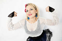 80s Girl Power. A woman dressed in 1980s attire flexing her muscles to show girl power Royalty Free Stock Images