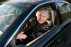 86 year old woman at her home, drivingn her car. 86 year old woman looking out driver's window Stock Photos