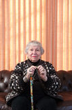 86 year old woman at her home, holding cane Stock Photography
