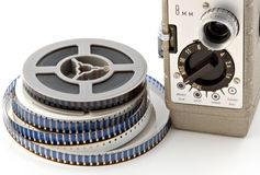 8mm Movie Camera & Reels. Old 8mm movie camera and film reels isolated on a white background stock images