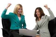 9名企业膝上型计算机二妇女工作 图库摄影
