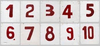 9 на белой доске переклейки Стоковая Фотография