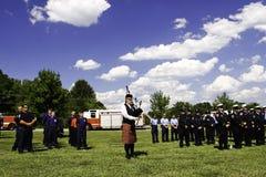9 11 кладут играть в мешки волынщика церемонии Стоковая Фотография RF