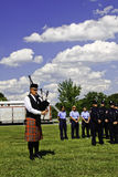 9 11 Ceremony Bag Piper Playing Amazing Grace. A member of the Concord Fire and Life Safety Department Pipe and Drum Band plays the hymn Amazing Grace while Royalty Free Stock Photo