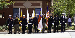 9 11 Ceremony Honor Guard with Colors. A mixed police, fire and sheriff's department ceremonial honor guard preparing to present the colors at a local ceremony stock photography
