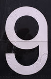 9. White painted number 9 on dark background royalty free illustration
