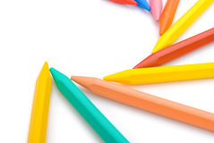 9-color crayon lined up in curved. With clipping path Stock Photo