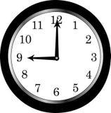 9 klocka o arkivfoto