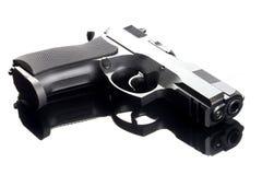 9 Millimeter-Handgewehr auf Glastabelle Stockbilder