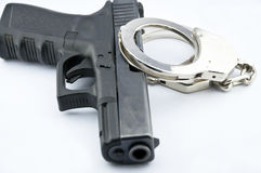 9-mm handgun automatic and police handcuff Stock Image