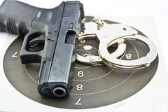 9-mm handgun automatic and police handcuff. On white background stock photo