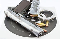 9-mm handgun automatic and police handcuff Stock Images