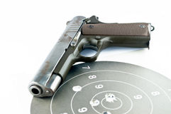 9-mm handgun and target shooting. On withe background stock photography