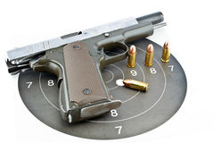 9-mm handgun and target shooting. On withe background royalty free stock photography