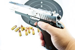 9-mm handgun and target shooting. On withe background stock photos