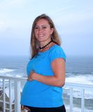 9 Months Pregnant. Beautiful woman who is nine months pregnant overlooking the beach on vacation Stock Images