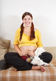 9 months pregnant woman is knitting Royalty Free Stock Photo