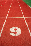 9 on a running track  line Royalty Free Stock Images