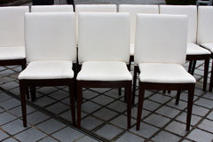 9 white chairs. On the backyard Stock Photography