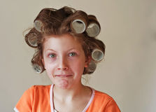 9 Year Old Girl's Hair in Curlers Humor Emotion Royalty Free Stock Image