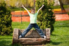 9 years old kid in a park Royalty Free Stock Image