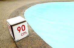 90 cm. water depth sign. At swimming pool Stock Photos