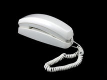 90's Corded Phone. An old corded phone isolated on a black background Royalty Free Stock Photos