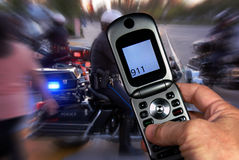 911 On The Cell. Dialing 911 on the cell phone at emergency scene, excitement indicated with motion blur Stock Images