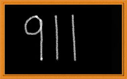 911 on Chalkboard. The number 911 written on chalkboard to indicate emergency and/or September 11th Stock Photos