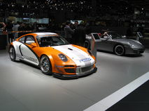 Porsche 911 GT3R Hybrid. Race version of the well known Porsche 911 (of which theres a street legal version in the background). This particular version with Stock Photo